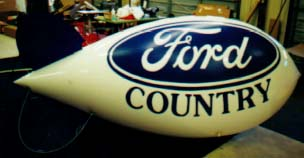 Advertising Blimp - 11ft. Ford Country logo. Helium blimps made in the USA.
