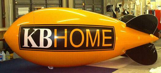 Advertising Blimp w/KB Home logo. 14ft. blimps w/o artwork are $665.00 and are our best selling blimps. 14ft. blimps with artwork from $1021.00. We have hundreds of advertising balloons in stock.